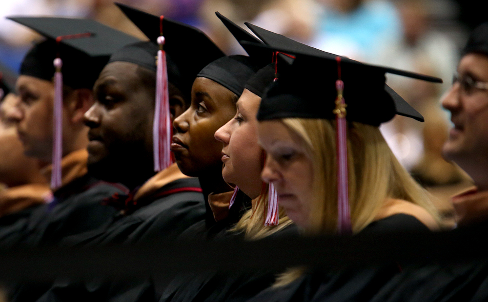 Graduates listen during the Commencement Saturday morning. David Spencer/The State Journal-Register