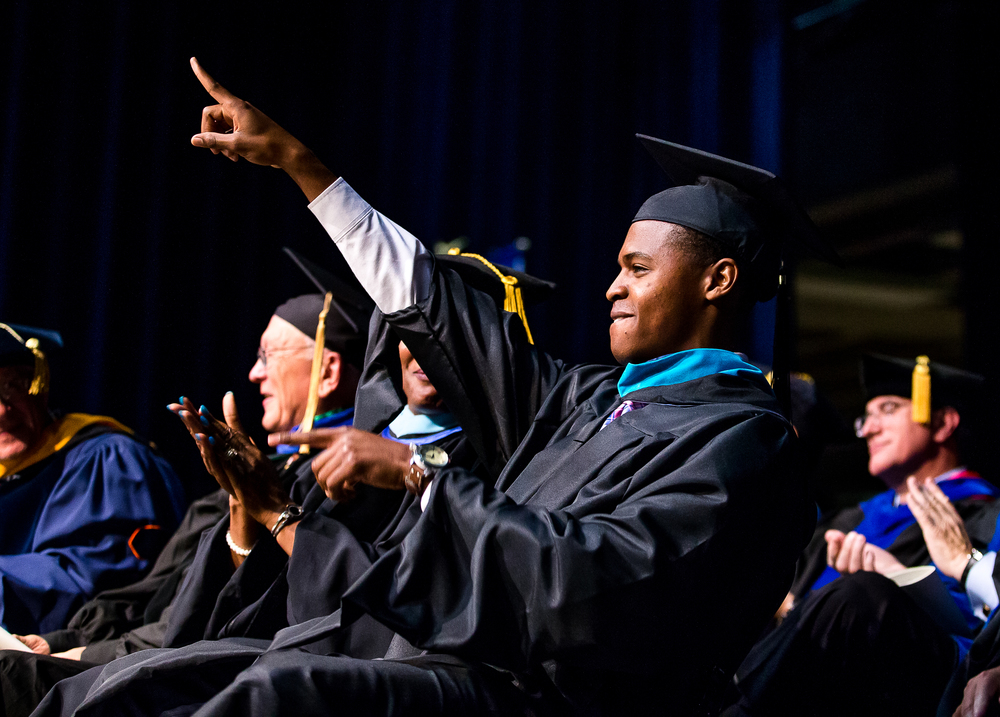 Blake Hudson, the student commencement speaker receiving a master�s degree in public administration, points to the crowd after delivering his speech during the University of Illinois Springfield's 44th Annual Commencement Ceremony at the Prairie Capital Convention Center, Saturday, May 16, 2015, in Springfield, Ill. Justin L. Fowler/The State Journal-Register