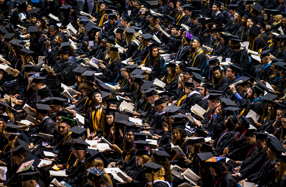 Graduates go through the program as they find their seats during the University of Illinois Springfield's 44th Annual Commencement Ceremony at the Prairie Capital Convention Center, Saturday, May 16, 2015, in Springfield, Ill. Justin L. Fowler/The State Journal-Register