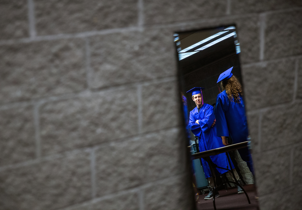Nick Slobodyanyuk waits downstairs with his fellow graduates as they prepare for the processional during the 99th Commencement for Pleasant Plains High School at Sangamon Auditorium, Sunday, May 17, 2015, in Springfield, Ill. Justin L. Fowler/The State Journal-Register