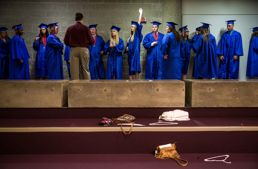 Rachel Lange, center, raises her hand to ask a question about the processional during the 99th Commencement for Pleasant Plains High School at Sangamon Auditorium, Sunday, May 17, 2015, in Springfield, Ill. Justin L. Fowler/The State Journal-Register