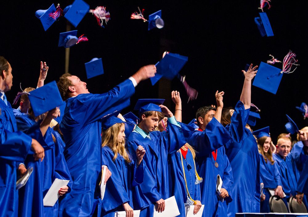 Graduates toss their caps into the air at the conclusion of the 99th Commencement for Pleasant Plains High School at Sangamon Auditorium, Sunday, May 17, 2015, in Springfield, Ill. Justin L. Fowler/The State Journal-Register