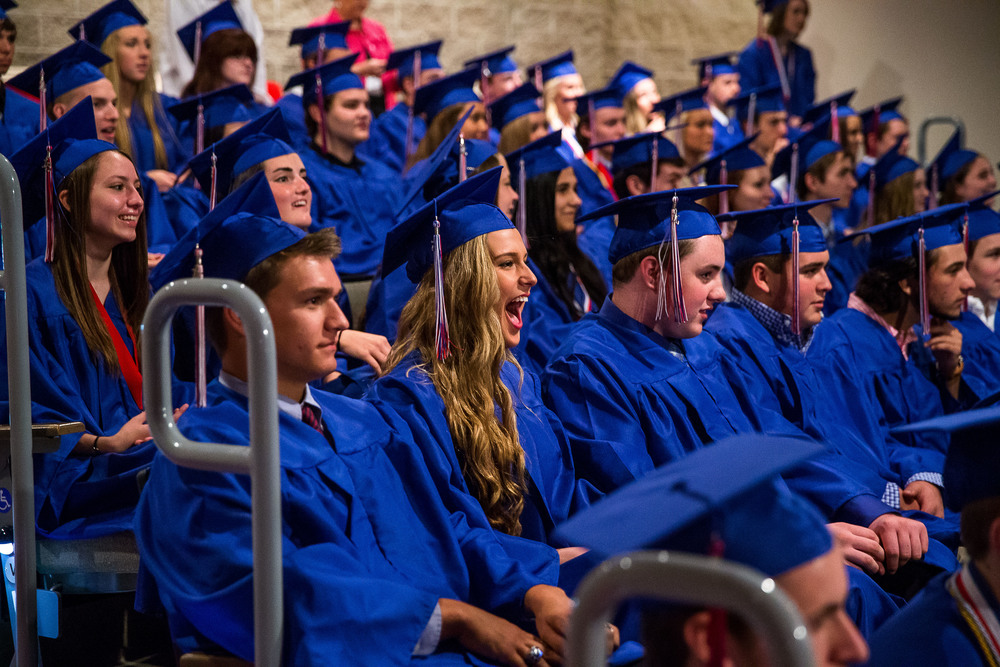 Graduates react as they watch a slideshow showing pictures from their early years during the 99th Commencement for Pleasant Plains High School at Sangamon Auditorium, Sunday, May 17, 2015, in Springfield, Ill. Justin L. Fowler/The State Journal-Register