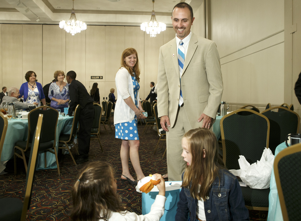 Jeff Lightfoot, the Horace Mann 2015 Educator of the Year, and his wife Stephanie watch their daughters Julia, left, and Elyse sort through a gift bag given to all the nominees for the award after a ceremony at the President Abraham Lincoln Hotel Monday, May 11, 2015. Ted Schurter/The State Journal-Register
