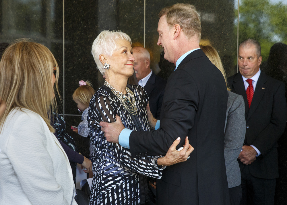 "Joan ""Jody"" Dixon greets her son Jeffrey after he spoke at a dedication ceremony to name the building that houses the Illinois State Museum building after his father, former U.S. Sen. Alan Dixon, Wednesday, May 13, 2015. The building is now called the Alan J. Dixon Building. Ted Schurter/The State Journal-Register"