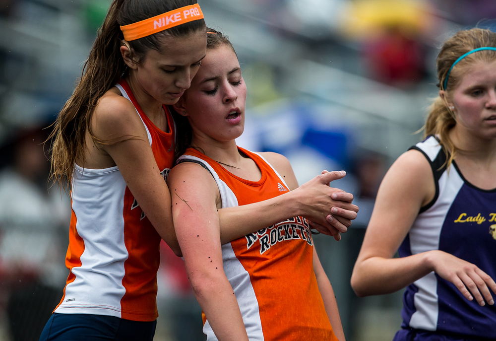 Rochester's Madeline Campbell is held up by her teammate, Ellie Tjeimeland, left, after winning the Girls 3200m Run during the Girls Class 2A Sectional Track Meet at  Southeast High School, Thursday, May 14, 2015, in Springfield, Ill. Justin L. Fowler/The State Journal-Register