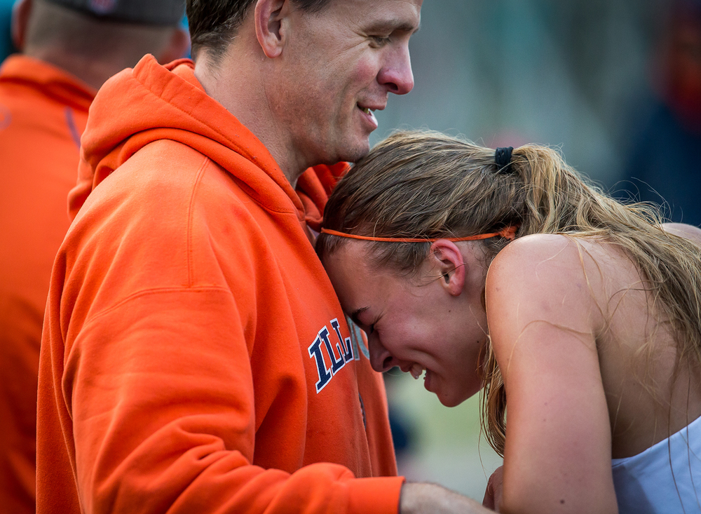 Rochester's Meagan McNicholas rests her head on her father, Mike McNicholas, after winning the Girls 800m Run during the Girls Class 2A Sectional Track Meet at  Southeast High School, Thursday, May 14, 2015, in Springfield, Ill. Justin L. Fowler/The State Journal-Register