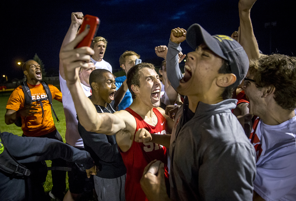 Springfield's Heath Warren, center, and Alex Deleon, right, celebrate with the team after winning the team title for the Boys Central State Eight Track & Field Meet at Glenwood High School, Friday, May 15, 2015, in Chatham, Ill. Justin L. Fowler/The State Journal-Register