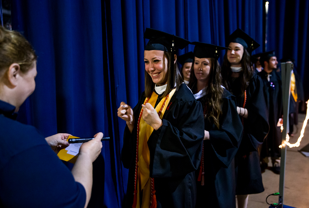 Kelsey Louise Townsend, the marshal representing the Master of Science graduates, shows her excitement backstage as she prepares to receive her diploma during the University of Illinois Springfield's 44th Annual Commencement Ceremony at the Prairie Capital Convention Center, Saturday, May 16, 2015, in Springfield, Ill. Justin L. Fowler/The State Journal-Register