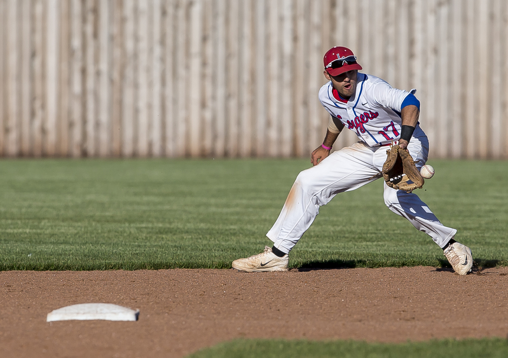 Lincoln Land Community College second baseman Zach Barnhart (17) backhands a ground ball for an out to end the 7th inning against John Wood during the NJCAA Region 24 Tournament at Claude Kracik Field, Monday, May 18, 2015, in Springfield, Ill. Justin L. Fowler/The State Journal-Register