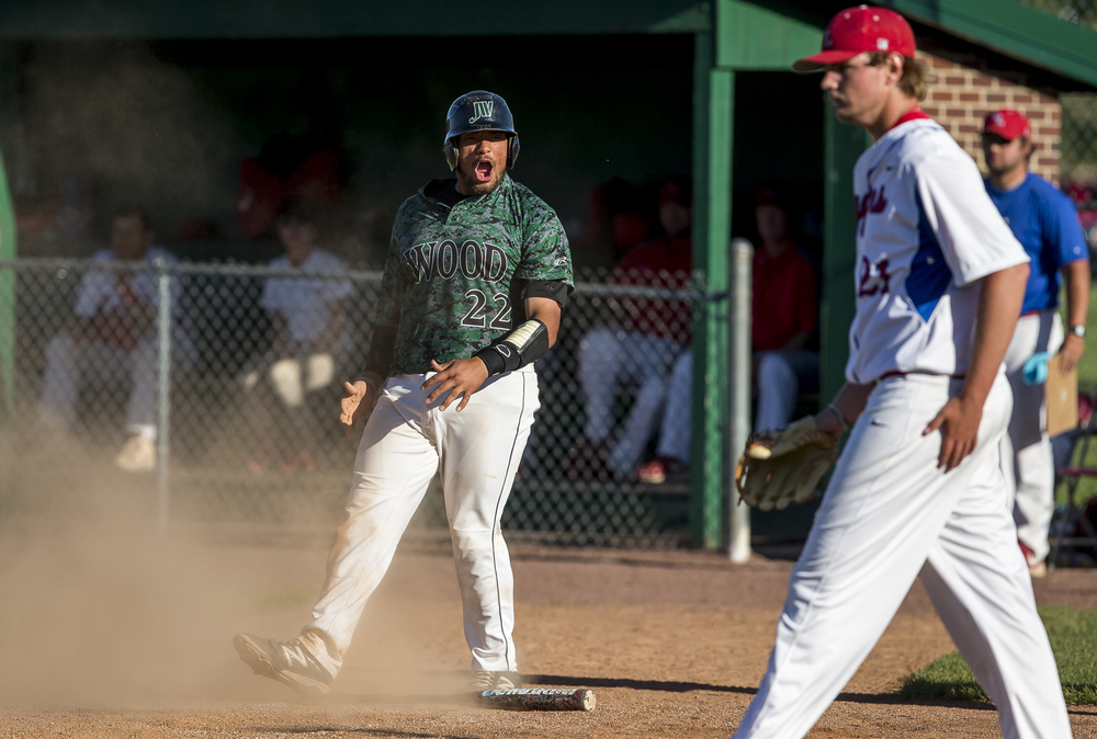 John Wood Community College's Jalen Poindexter (22) reacts after scoring a run in the 7th inning to make it 3-1 against Lincoln Land Community College during the NJCAA Region 24 Tournament at Claude Kracik Field, Monday, May 18, 2015, in Springfield, Ill. Justin L. Fowler/The State Journal-Register