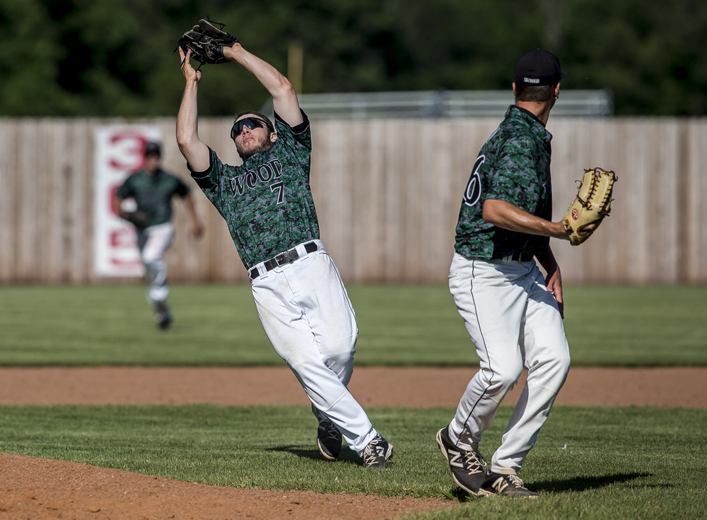 John Wood Community College second baseman Jansen Smith (7) catches a fly ball from Lincoln Land Community College to end the 3rd Inning during NJCAA Region 24 Tournament at Claude Kracik Field, Monday, May 18, 2015, in Springfield, Ill. Justin L. Fowler/The State Journal-Register