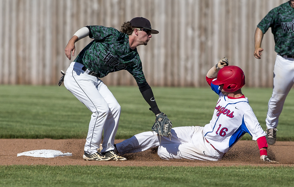 Lincoln Land Community College's Tyler Ring (16) is called safe sliding into second against John Wood Community College shortstop Zane Corbell (12) in the 3rd inning during the NJCAA Region 24 Tournament at Claude Kracik Field, Monday, May 18, 2015, in Springfield, Ill. Justin L. Fowler/The State Journal-Register