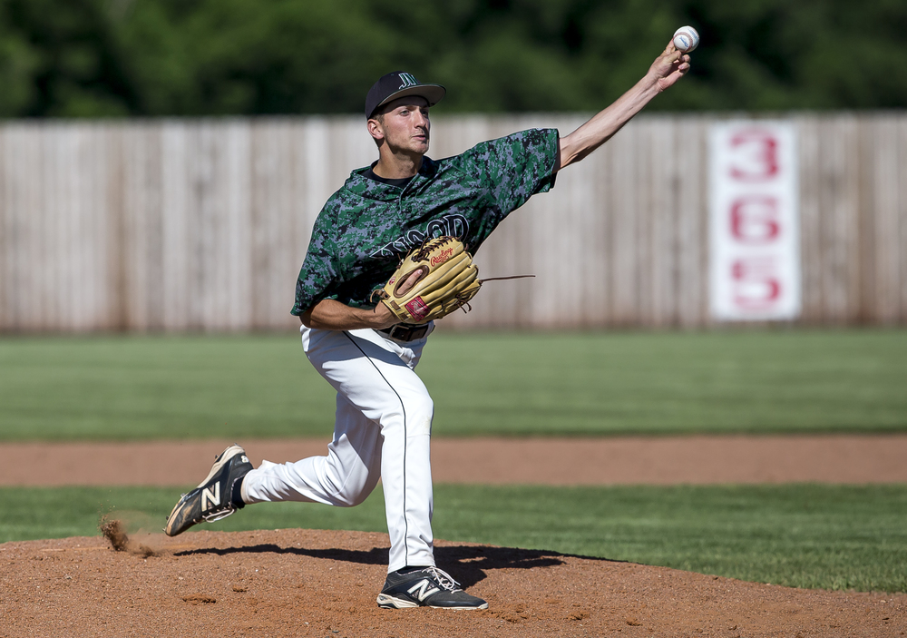 John Wood Community College starting pitcher Sal Martorano (46) delivers to the plate against Lincoln Land in the 2nd inning during the NJCAA Region 24 Tournament at Claude Kracik Field, Monday, May 18, 2015, in Springfield, Ill. Justin L. Fowler/The State Journal-Register