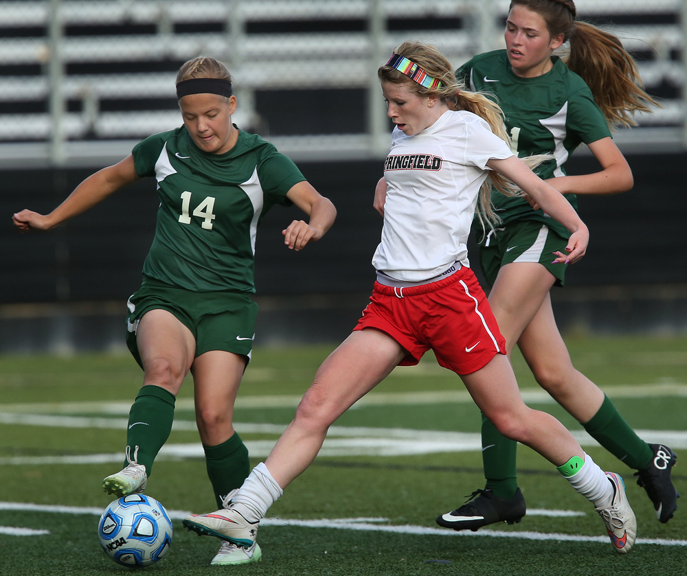 Springfield's Katie Collins prepares to take charge in route to scoring her team's fifth goal of the game Tuesday. At right is Lincoln defender Grace Skelton. David Spencer/The State Journal-Register