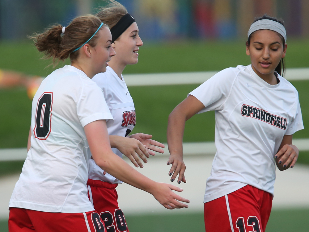 Springfield player Lauren Browing at center gets some low fives from teammates Aliva Dubois at left and Marissa Barria after she scored her team's seventh goal of the game Tuesday night.  David Spencer/The State Journal-Register