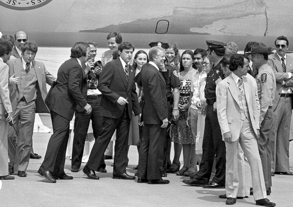 President Jimmy Carter is met by invited guests after landing at Capital Airport May 26, 1978. Carter appeared before a joint session of the Illinois General Assembly and attended a breakfast fundraiser while in Springfield. File/The State Journal-Register