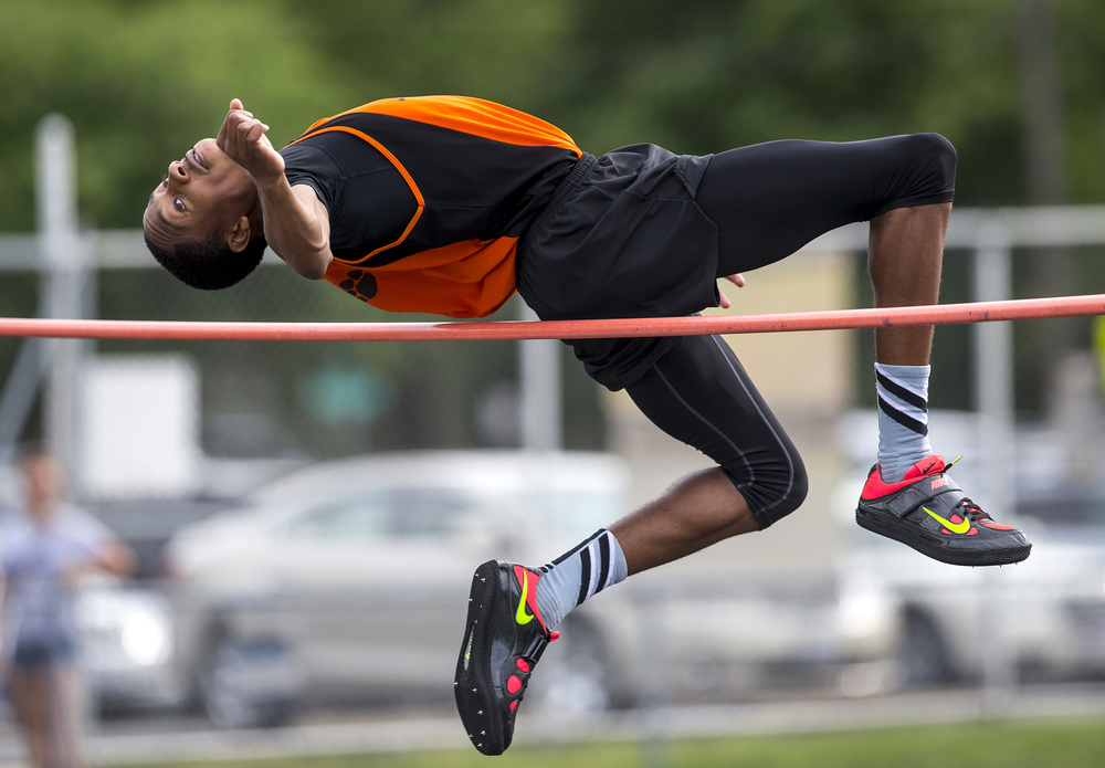 Lanphier's Kendrick Griffin clears 6-4 to win the Boys High Jump and setting a new PR during the Class 2A Springfield Sectional Track and Field Meet at Memorial Stadium, Friday, May 22, 2015, in Springfield, Ill. Justin L. Fowler/The State Journal-Register