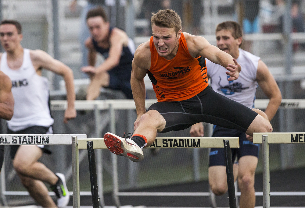 Hillsboro's Cole Deming takes the win in the Boys 110m Hurdles during the Class 2A Springfield Sectional Track and Field Meet at Memorial Stadium, Friday, May 22, 2015, in Springfield, Ill. Justin L. Fowler/The State Journal-Register