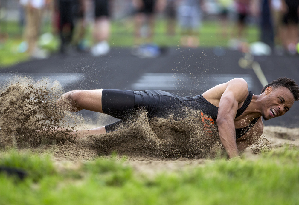 Lanphier's Daryl Jackson hits the sand while competing in the Boys Long Jump during the Class 2A Springfield Sectional Track and Field Meet at Memorial Stadium, Friday, May 22, 2015, in Springfield, Ill. Jackson finished third with jump of 21-08.50. Justin L. Fowler/The State Journal-Register