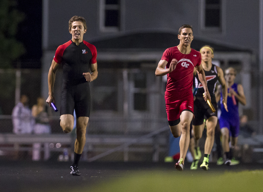 Highland's Brode Portell, left, and Glenwood's Dominick Giovannelli battle it out in the final stretch of the Boys 4x400m Relay during the Class 2A Springfield Sectional Track and Field Meet at Memorial Stadium, Friday, May 22, 2015, in Springfield, Ill. Highland finish first with a time of 3:24.08 and Glenwood came in second with a time of 3:25.17. Justin L. Fowler/The State Journal-Register
