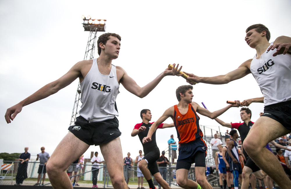 Sacred Heart-Griffin's Dustin Moles, left, takes the baton from Ethan Bluhm to run the second leg of the 4x800m Relay during the Class 2A Springfield Sectional Track and Field Meet at Memorial Stadium, Friday, May 22, 2015, in Springfield, Ill.  SHG finished fourth with a time of 8:07.48. Justin L. Fowler/The State Journal-Register
