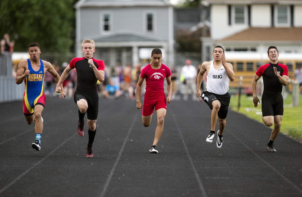 Highland's Tyler Higgins, second from left, takes the victory in the Boys 100m Dash with a time of 10.95 during the Class 2A Springfield Sectional Track and Field Meet at Memorial Stadium, Friday, May 22, 2015, in Springfield, Ill. Justin L. Fowler/The State Journal-Register