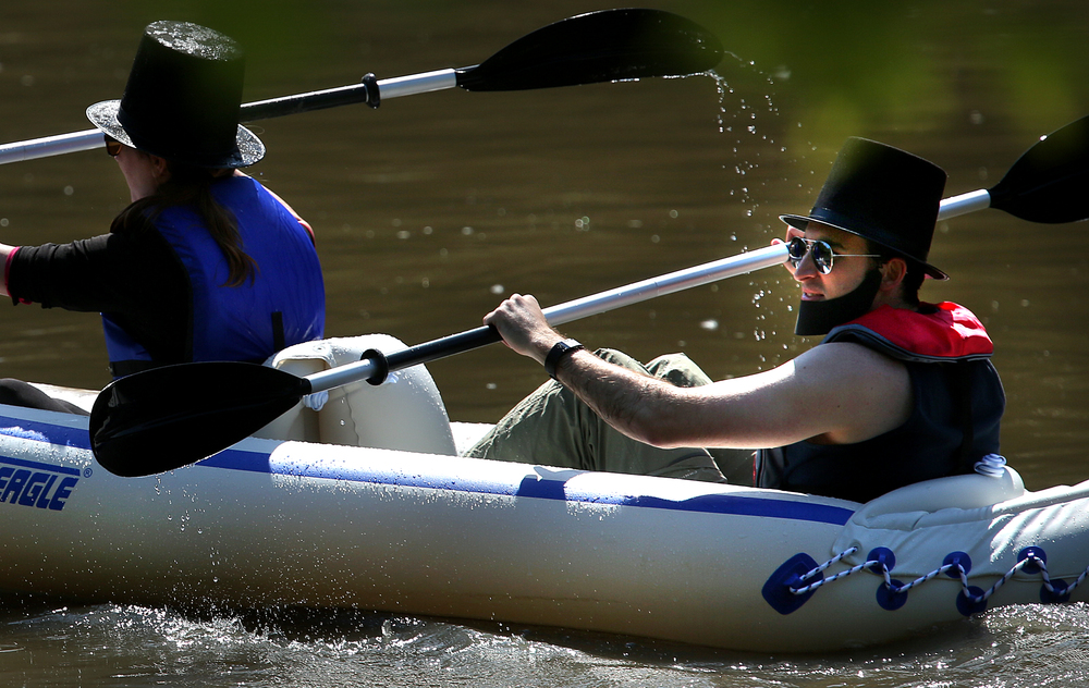 First time racer Joey Pulito of Springfield decided to wear a beard and stovepipe hat in honor of Abe along with his kayak partner Sara Hewitt as they set out at the start of the race on Saturday morning. David Spencer/The State Journal-Register