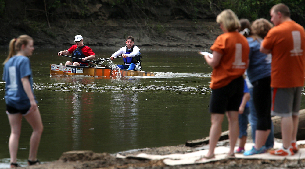 Racing in a Kevlar marathon racing canoe, paddlers Dave Buckley of Morris at front and Nick Josefik of St. Joseph look to the race officials as they are the first boat to cross the finish line Saturday morning with a time of one hour, 38 minutes. David Spencer/The State Journal-Register