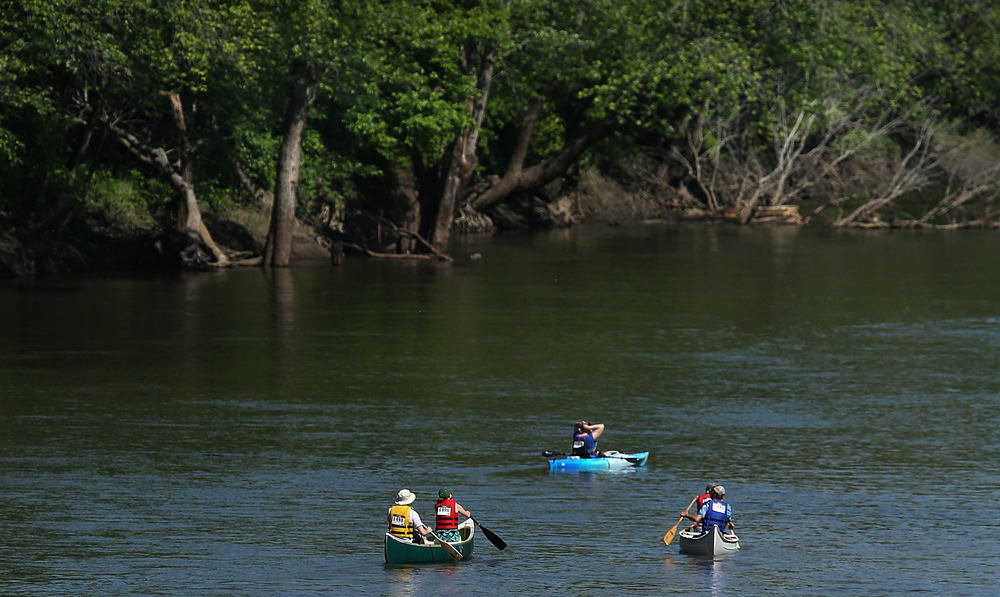 Paddlers head north on the Sangamon River just past Irwin Bridge Saturday morning. David Spencer/The State Journal-Register