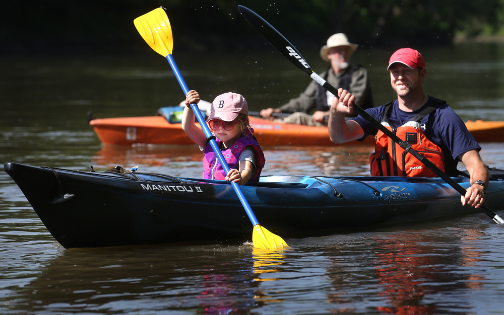 Brooke Batsie, 6 of Washington, MO paddles at front along with her dad Michael Batsie as they head out in their kayak at the start of the race Saturday morning. David Spencer/The State Journal-Register