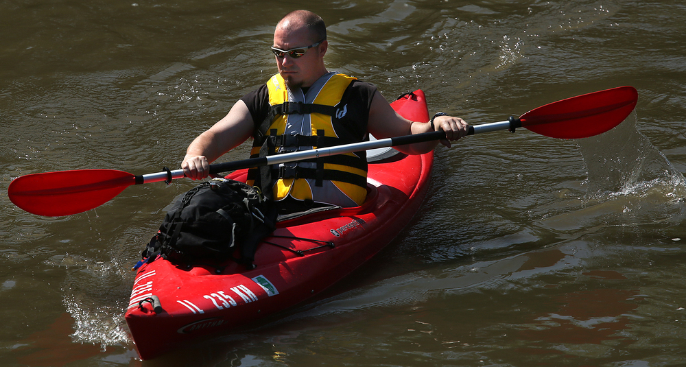 Paddler Mike Tyree prepares to go underneath Irwin Bridge shortly after the start of the race Saturday. David Spencer/The State Journal-Register