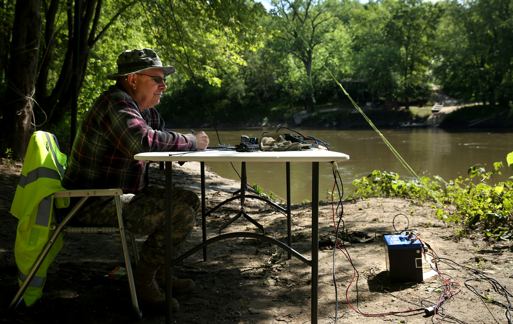 In addition to Menard County Rescue, who were in boats on the river, 16 ham radio operators staggered along the river banks provided secure communications, support and additional safety for the race. Operator Ray Lloyd of New Berlin had two antennas set up near Irwin Bridge, with a car battery at right providing power for his radio rig. David Spencer/The State Journal-Register