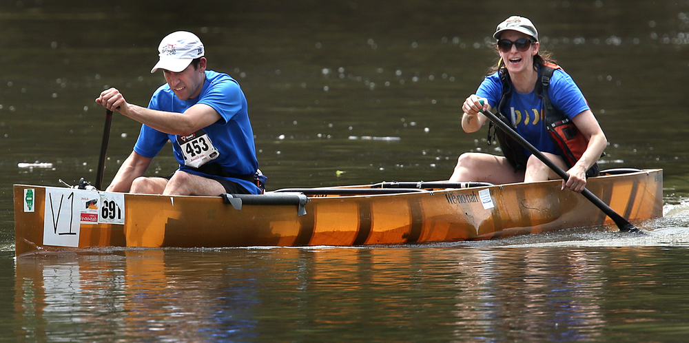 Brother and sister Ben Josefik of Dwight and Adrienne Josefik of St. Joseph, racing in a Kevlar marathon racing canoe, cross the finish line at Riverside Park with a time of one hour, 34 minutes. David Spencer/The State Journal-Register