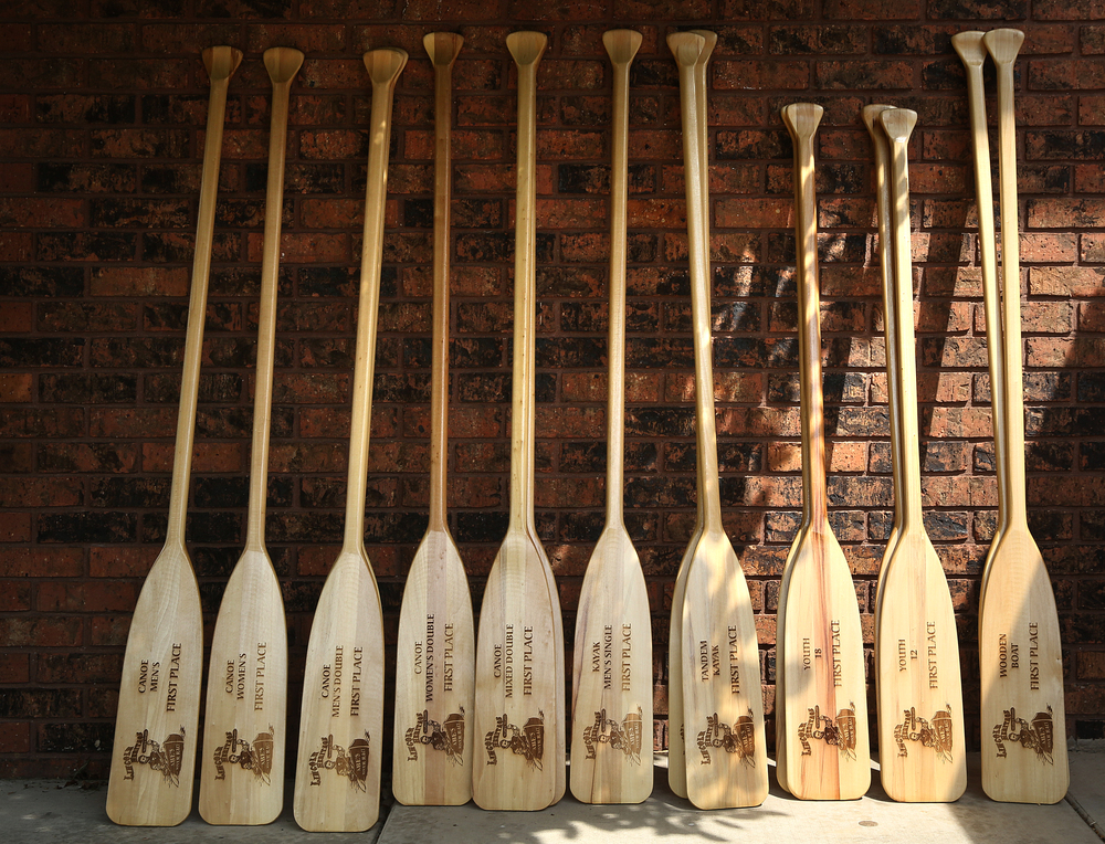 First place trophies: engraved wood canoe paddles, wait to be awarded later Saturday at Riverbank Lodge in Petersburg. David Spencer/The State Journal-Register