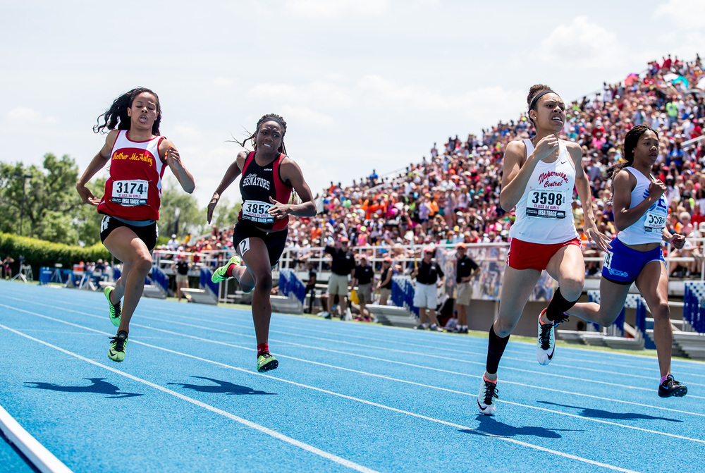 Springfield's Ozzy Erewele, second from left, finished 9th with a time of 12.32 in the Class 3A 100m Dash during the IHSA Girls Track and Field State Finals at O'Brien Stadium, Saturday, May 23, 2015, in Charleston, Ill. Justin L. Fowler/The State Journal-Register