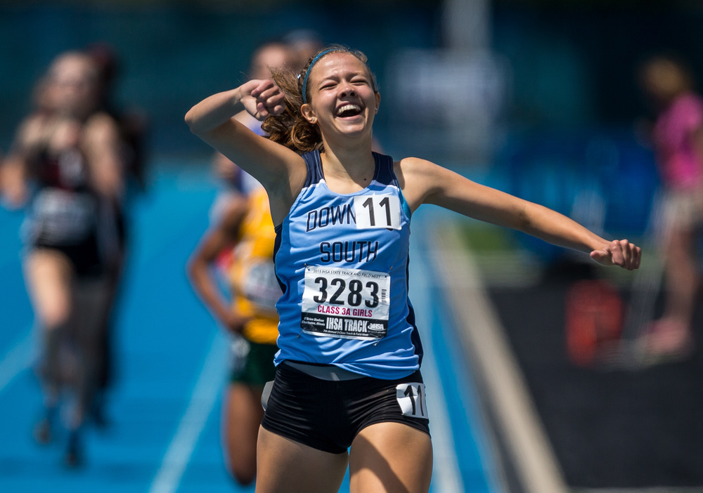 Downers Grove South's Michaela Hackbarth celebrates after winning the Class 3A 800m Run with a time of 2:11.24 during the IHSA Girls Track and Field State Finals at O'Brien Stadium, Saturday, May 23, 2015, in Charleston, Ill. Justin L. Fowler/The State Journal-Register