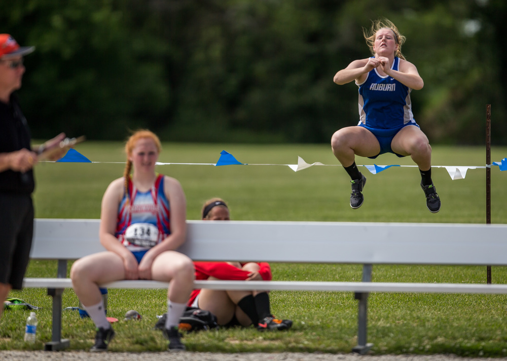 Auburn's Katie Gonterman leaps into the air as she gets warmed up prior to the start of the Class 1A Shot Put during the IHSA Girls Track and Field State Finals at O'Brien Stadium, Saturday, May 23, 2015, in Charleston, Ill. Justin L. Fowler/The State Journal-Register