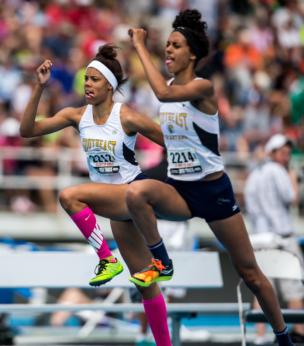 Southeast's Jamari Drake and Lunden Henry get warmed up for the Class 2A High Jump during the IHSA Girls Track and Field State Finals at O'Brien Stadium, Saturday, May 23, 2015, in Charleston, Ill. Justin L. Fowler/The State Journal-Register