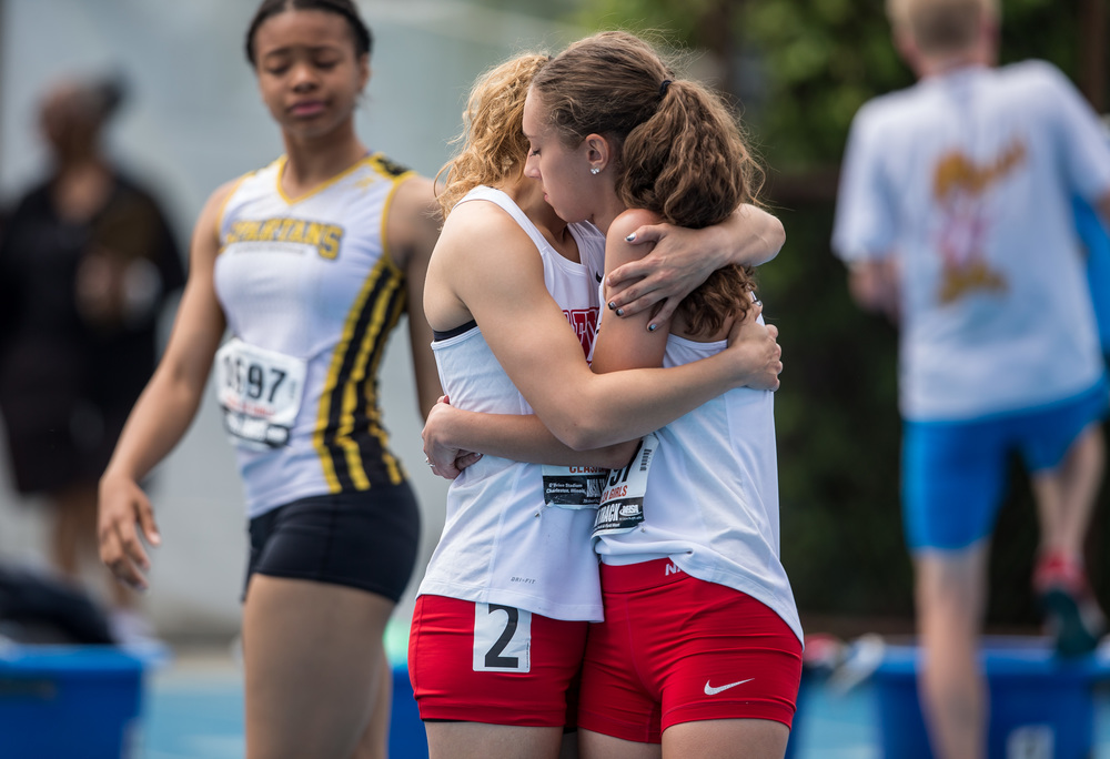 Glenwood's Alicia Windisch and Mackenzie McClintock pause for a moment prior to the Class 2A 4x100m Relay during the IHSA Track and Field State Finals at O'Brien Stadium, Saturday, May 23, 2015, in Charleston, Ill. Glenwood finished 8th with a time of 49.51. Justin L. Fowler/The State Journal-Register