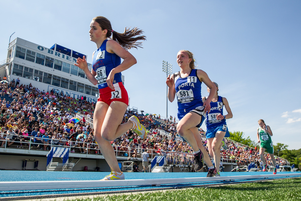 St. Anthony's Anna Sophia Keller and PORTA's Maria Brauer (581) and Adrienne Brauer (580) head down the front stretch heading into the final lap of the Class 1A 1600m Run during the IHSA Girls Track and Field State Finals at O'Brien Stadium, Saturday, May 23, 2015, in Charleston, Ill. Justin L. Fowler/The State Journal-Register