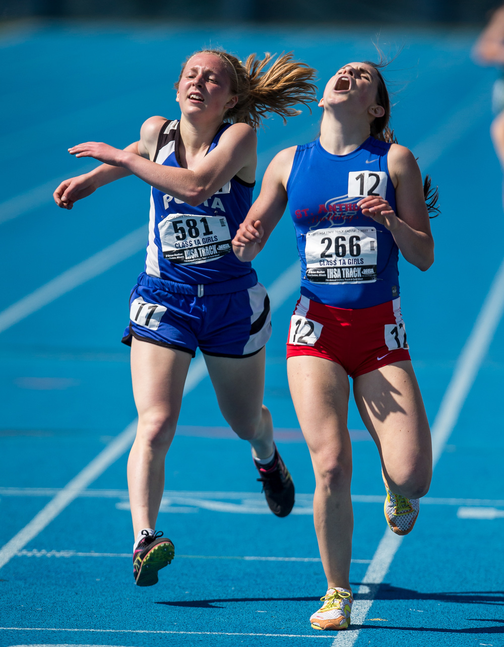 St. Anthony's Anna Sophia Keller narrowly defeats PORTA's Maria Brauer in the Class 1A 1600m Run during the IHSA Girls Track and Field State Finals at O'Brien Stadium, Saturday, May 23, 2015, in Charleston, Ill. Justin L. Fowler/The State Journal-Register