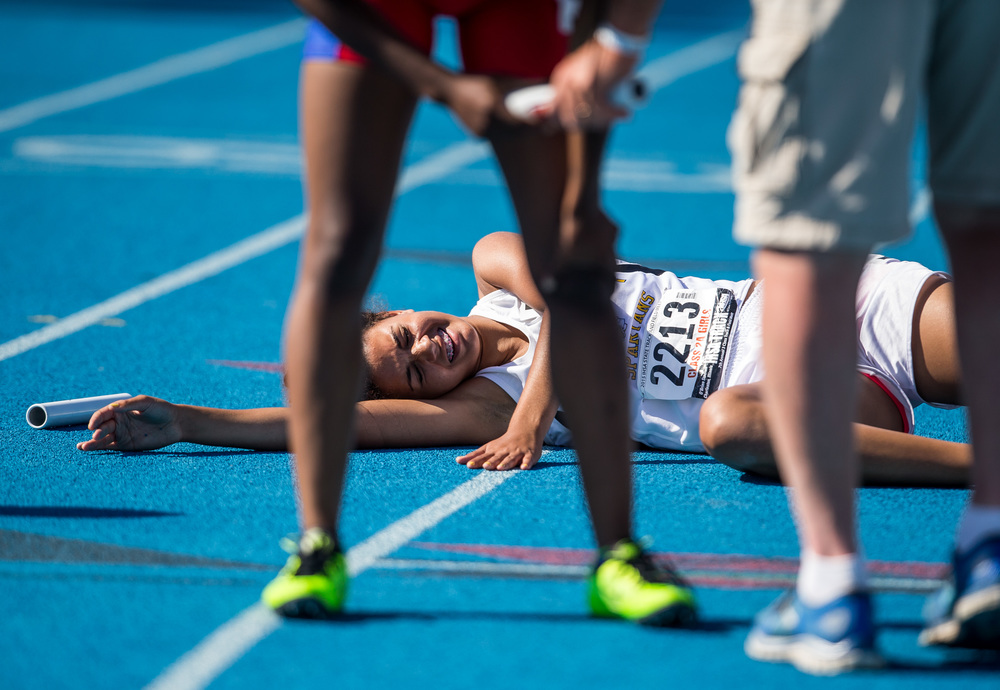 Southeast's Alexis Henry collapses to the track after running the final leg of the Class 2A 4x400m Relay during the IHSA Track and Field State Finals at O'Brien Stadium, Saturday, May 23, 2015, in Charleston, Ill. Southeast finished fourth with a time of 3:59.85. Justin L. Fowler/The State Journal-Register