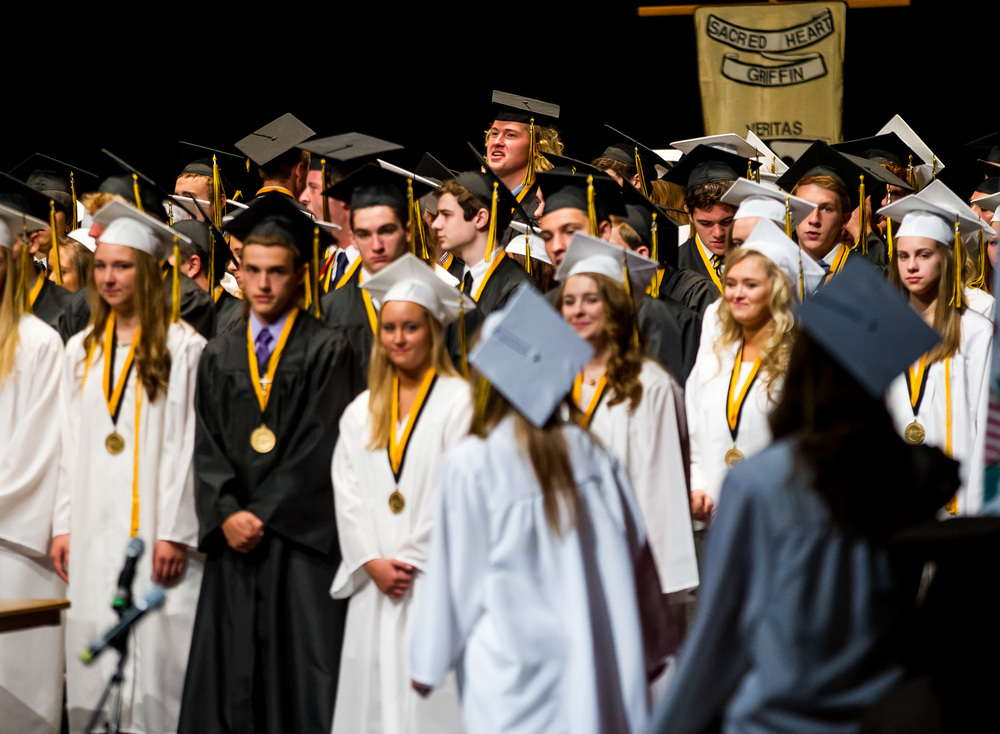 """At a height of 6' 7"""" Quinn Oseland looks out over his fellow graduates as they take the stage during the graduation ceremony for Sacred Heart-Griffin at Sangamon Auditorium , Sunday, May 24, 2015, in Springfield, Ill. Justin L. Fowler/The State Journal-Register"""