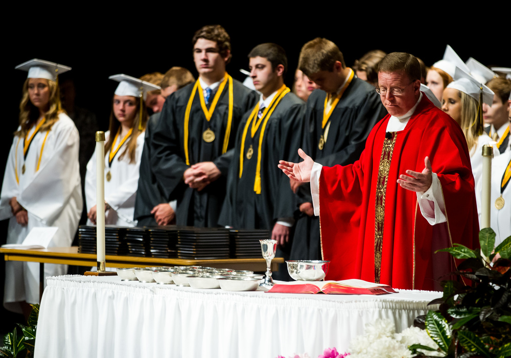 Father David Hoefler delivers the eucharistic prayer  during Mass prior to the graduation ceremony for Sacred Heart-Griffin at Sangamon Auditorium , Sunday, May 24, 2015, in Springfield, Ill. Justin L. Fowler/The State Journal-Register
