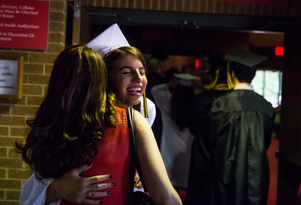 Madeline Reavy gets a hug from her sister, Amanda, as the Sacred Heart-Griffin graduates make their way to the stage during the graduation ceremony for Sacred Heart-Griffin at Sangamon Auditorium , Sunday, May 24, 2015, in Springfield, Ill. Justin L. Fowler/The State Journal-Register