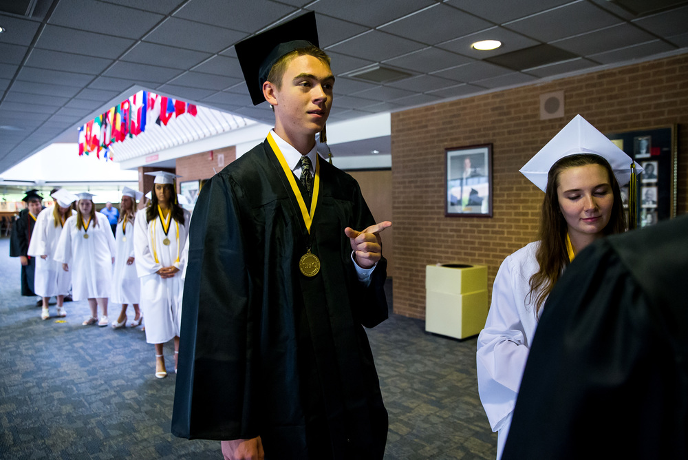 Sacred Heart-Griffin graduate Will Smith waits outside the auditorium as the graduates prepare for the processional during the graduation ceremony for Sacred Heart-Griffin at Sangamon Auditorium , Sunday, May 24, 2015, in Springfield, Ill. Justin L. Fowler/The State Journal-Register