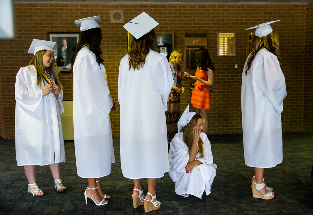 Clare Stannard takes a break as the graduates wait for the processional to begin during the graduation ceremony for Sacred Heart-Griffin at Sangamon Auditorium , Sunday, May 24, 2015, in Springfield, Ill. Justin L. Fowler/The State Journal-Register