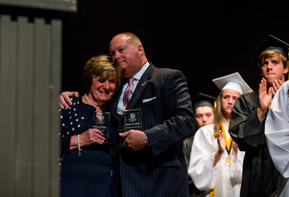 Paul John Staab II, right, gives Kathleen Cory, left, a hug after she represented her late husband, Simon Cory, during the Hall of Fame Induction for Sacred Heart-Griffin prior to the graduation ceremony for at Sangamon Auditorium , Sunday, May 24, 2015, in Springfield, Ill. Paul John Staab II and Simon Cory, both alumni of Griffin High School, were inducted into the school's hall of fame. Justin L. Fowler/The State Journal-Register