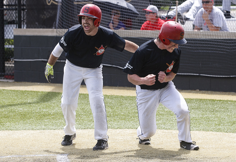 Tanner Maskey, left, and Matt Thomson celebrate their runs against Jacksonville during the 3A SHG Regional Monday, May 25, 2015.  Ted Schurter/The State Journal-Register